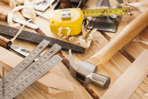 carpenter tools,hammer,meter,nails, and chisel over wood table