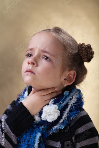 Little girl with sore throat in flu season