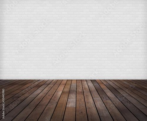 canvas print picture Raum: Weisse Ziegelwand mit Holzfussboden