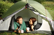 Couple lying in a tent, camping serie