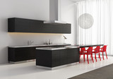 Contemporary minimal dark wood kitchen with red plastic chairs