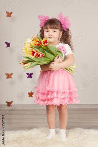 Portrait of girl with tulips