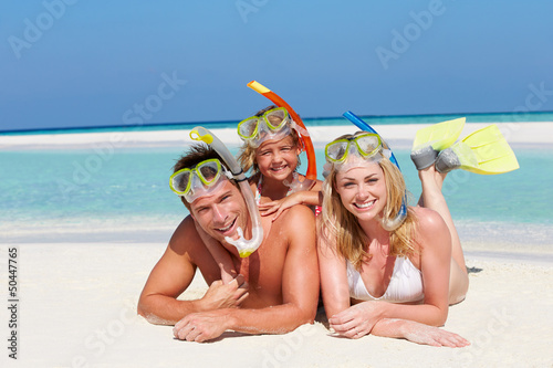 Family With Snorkels Enjoying Beach Holiday