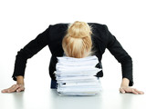 Overworked business woman at work has a headache