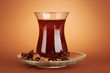 glass of Turkish tea, on brown background