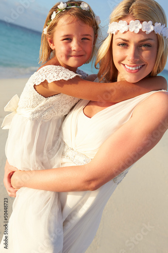 Bride With Bridesmaid At Beautiful Beach Wedding