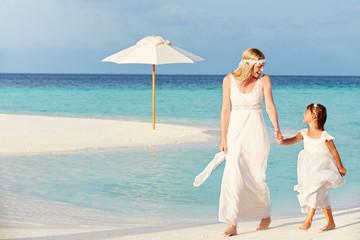 Bride With Bridesmaid At Beautiful Beach Wedding