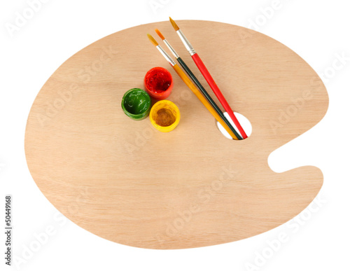Wooden art palette with brushes for painting and paints