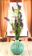 Decorative ceramic vase with lavender