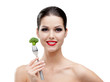Woman with red lipstick eating healty broccoli on the fork