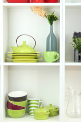 Beautiful white shelves with tableware and decor.