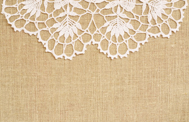 Canvas background with crochet lace