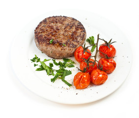 Beef steak and baked tomatoes