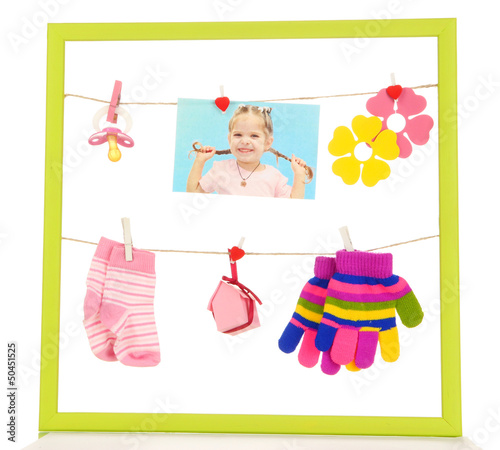 Colorful frame with different things on rope isolated on white