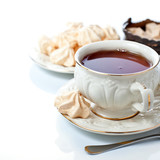 Elegant tea cup and freah meringues
