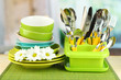 Plates, forks, knives, spoons and other kitchen utensil
