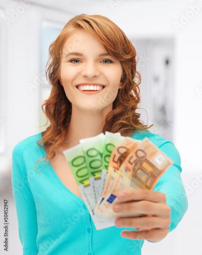 happy teenage girl with euro cash money