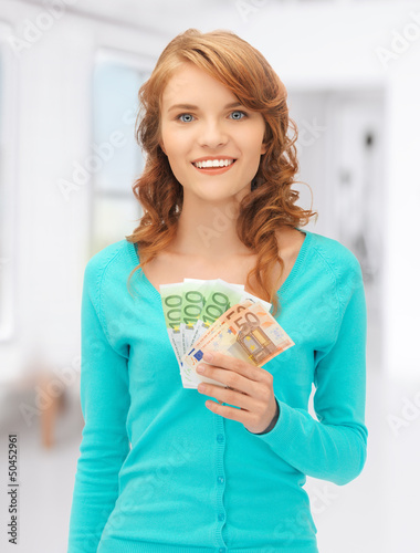 happy teenage girl with euro cash money
