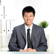 Confident happy young Asian businessman