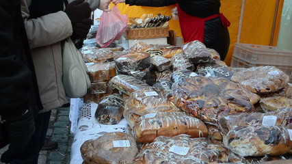 People buy flour products sugary cakes bread outdoor market fair