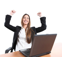 Euphoric businesswoman in an office with a laptop