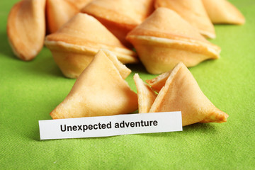 Fortune cookies on green tablecloth