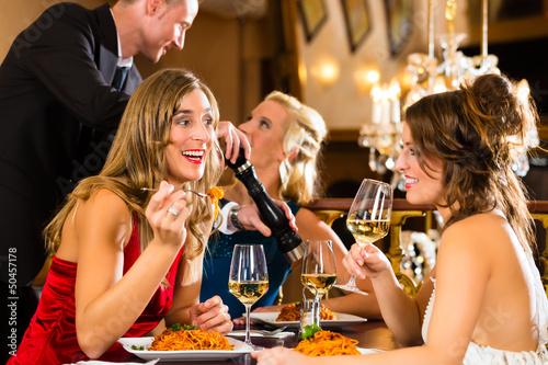 Waiter spices the dinner in a fine restaurant