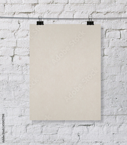 brick wall with blank poster