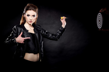 punk girl with dart and target black background