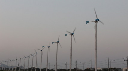 Wind turbines produce electricity with sky