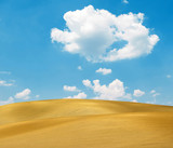 Sand dunes and bright blue sky