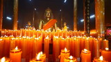 Dolly: Buddha statuettes with candles in temple,HD 1080P