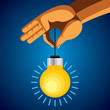 person holding colorful bright incandescent light bulb