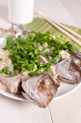 Healthy cooked whole fish with scallions and cilantro