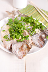 Steamed fish whole with green onions