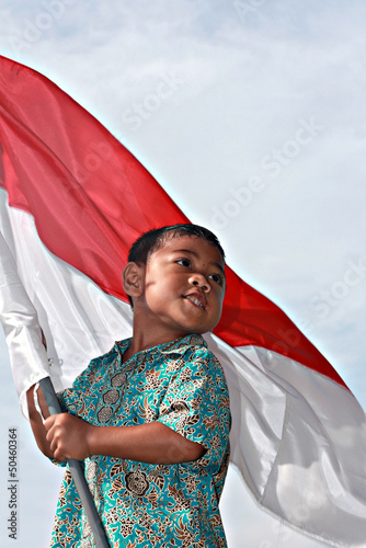 Indonesian children proudly wearing batik