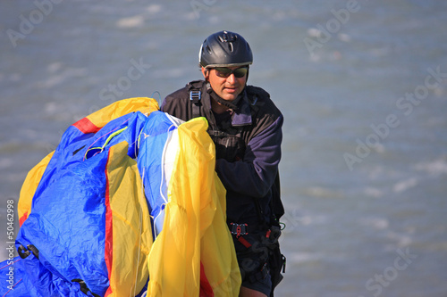 paraglider carrying his wing