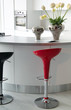 White kitchen black and red stools