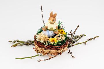 porcelain hare sitting in a wicker basket