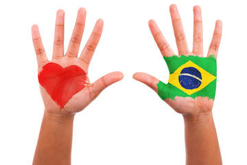 Brazilian hands with a painted heart and brazilian flag, i love