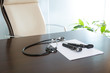Doctor office table desk with stethoscope and otoscope