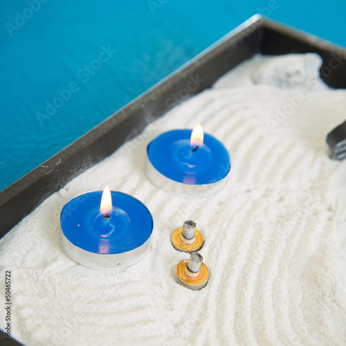 Zen little garden with blue candles and moxa