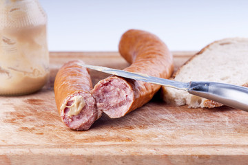 Traditional pork sausage with mustard