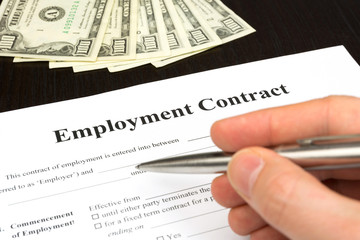 employment contract with dollar, hand and pen
