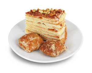 Cake with nuts and chocolate crumbs and two gingerbreads