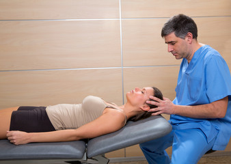 cranial osteopathy therapy doctor hands in woman head