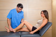 knee examination doctor to woman patient