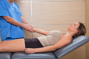 fascial therapy doctor pulling patient woman arm