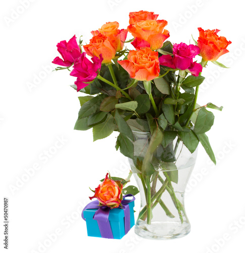 bouquet of  orange roses  in vase and  gift box