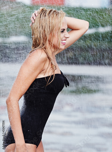 woman in rain on street